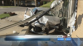 Car hits building, two injured