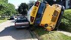 School bus flips, hits pickup at 37th