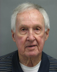 Retired priest suspended following arrest