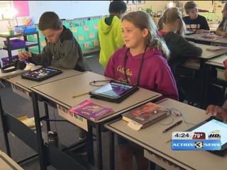 Teacher uses standing desks to help students