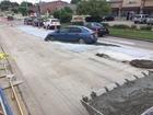 Lincoln driver skids into fresh concrete