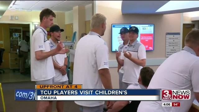 TCU players and coaches meet patients