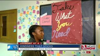 Student makes post its with kind words for...